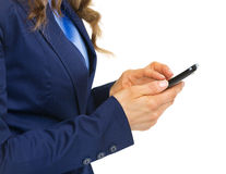 Closeup on business woman writing sms Stock Images