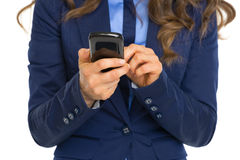 Closeup on business woman writing sms Stock Photo