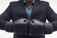 Closeup businessman in boxing gloves isolated on Stock Photo