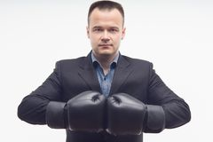 Closeup businessman in boxing gloves isolated on Stock Photography