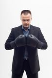 Closeup businessman in boxing gloves isolated on Royalty Free Stock Images
