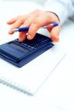 Closeup of a businessman calculating Stock Photos