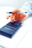 Closeup of a businessman calculating Stock Images