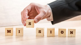 Closeup of businessman creating a word Mission with seven wooden Stock Photography