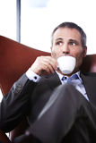 Closeup of businessman enjoying coffee. Royalty Free Stock Photos