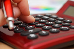 Closeup of businessman finger pressing on  key on calculator Royalty Free Stock Photo