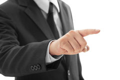 Closeup businessman finger touching an imaginary screen Isolated Stock Images