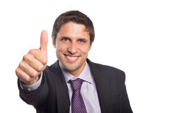 Closeup of a businessman gesturing thumbs up Stock Image