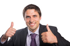Closeup of a businessman gesturing thumbs up Stock Photos