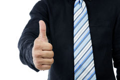 Closeup of businessman giving thumbs up sign Royalty Free Stock Photography