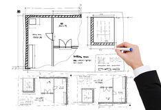 Closeup of businessman hand drawing blueprint Stock Photography