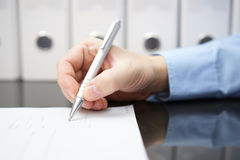 Closeup of businessman hand with pen when signing document. Busi Stock Photo