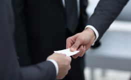 Businessman handing business card to the partner. Closeup.businessman handing business card to the partner royalty free stock photos