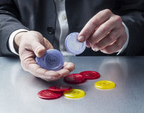 Closeup on businessman hands playing with casino chips for concept of gambling or job opportunity Stock Photography