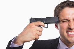 Closeup of a businessman holding a gun to head Royalty Free Stock Photography