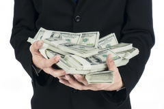 Closeup of businessman holding a lot of US Dollars in his hand Royalty Free Stock Image