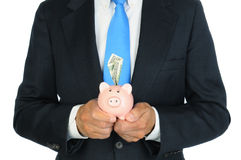 Businessman Holding Piggy Bank Royalty Free Stock Photography