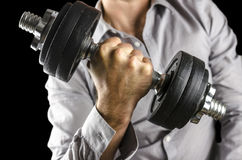 Closeup of businessman lifting weights Royalty Free Stock Photo