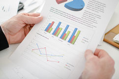 Closeup of businessman looking at a graph Stock Images