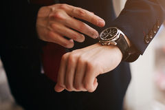 Closeup businessman looks at his luxury watch Stock Photography