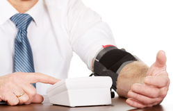 Closeup on businessman measuring blood pressure Royalty Free Stock Photography
