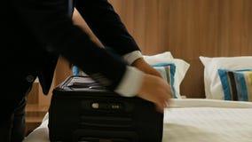 Closeup businessman packing suitcase. Closeup of businessman packing suitcase stock video