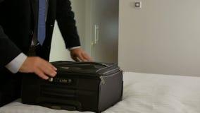Closeup businessman packing suitcase. Close up businessman packing suitcase stock video