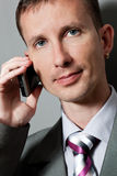 Closeup businessman with phone. Over gray Royalty Free Stock Photo
