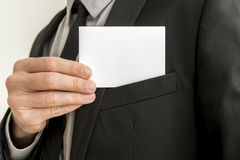 Closeup of businessman removing a blank business card from the p royalty free stock photos