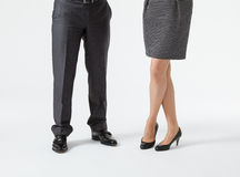 Closeup of businessman's and businesswoman's legs. On the floor stock photography