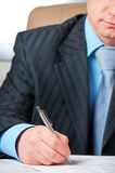 Closeup of businessman`s hand signing contract. This is a closeup of businessman`s hand signing contract royalty free stock image