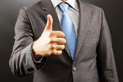 Closeup of a businessman  showing thumb up Royalty Free Stock Image