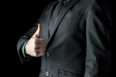 Closeup of businessman showing a thumbs up sign Stock Image