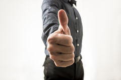 Closeup of businessman showing a thumbs up sign towards you Royalty Free Stock Image