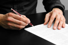 Businessman signing a contract. Closeup of businessman signing a contract Royalty Free Stock Images
