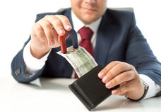 Closeup of businessman stealing money from wallet with magnet Royalty Free Stock Photo
