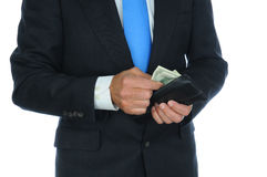 Businessman Taking Cash From Wallet Royalty Free Stock Images