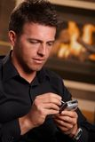 Closeup of businessman using mobile Royalty Free Stock Images