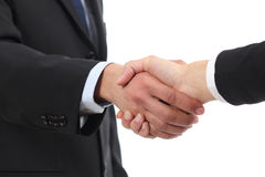 Closeup of a businessman and woman hands handshaking Stock Photography