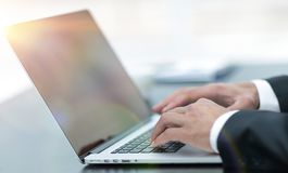 Closeup.businessman working on laptop. On blurred background stock photos