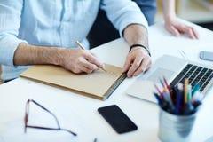 Closeup of Businessman Writing at Work Stock Image