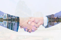Closeup of businessmans handshake isolated on white background Stock Photo