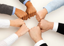 Closeup of businesspeople hands in fists in circle Royalty Free Stock Image