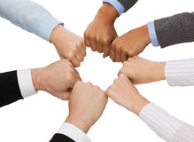 Closeup of businesspeople hands in fists in circle. Business and teamwork concept - closeup of businesspeople hands in fists in circle Royalty Free Stock Photo