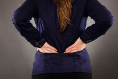 Closeup of businesswoman with back pain Royalty Free Stock Images