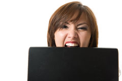 Closeup businesswoman bite laptop. Royalty Free Stock Photo
