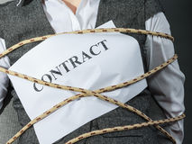 Closeup of businesswoman bound by contract terms. Stock Images