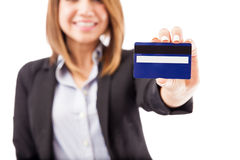 Closeup of businesswoman with credit card Royalty Free Stock Images