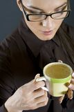 Closeup of a Businesswoman with a cup of coffee Royalty Free Stock Images