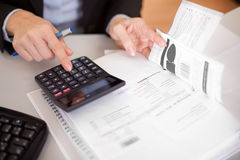 Closeup of a businesswoman doing finances Royalty Free Stock Image